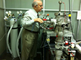 Dr. Dr. Huseyin R. Hiziroglu, Professor of Electrical Engineering, is preparing the experimental setup for evaluating the swarm parameters in gaseous dielectrics., Professor of Electrical Engineering, is preparing the experimental setup for evaluating the swarm parameters in gaseous dielectrics.